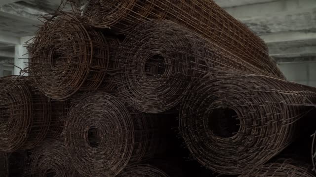 steel mesh wired for construction,strong and strength building structure.pan right camera. - l'uomo e la macchina video stock e b–roll
