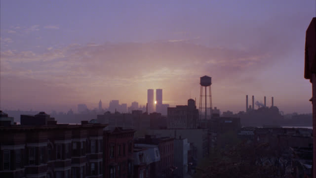 wide angle pov from rooftop in brooklyn of new york city, downtown manhattan skyline. sun rising behind world trade center twin towers. brooklyn navy yard water tower. multi-story brick apartment buildings. - brooklyn new york stock videos & royalty-free footage