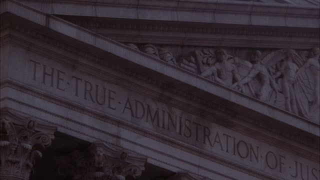 pan left to right of inscription on civil branch of new york supreme court building, downtown. neoclassical columns or pillars. government building. people on sidewalk and stairs. architecture, carvings or sculpture. courthouse. - supreme court stock videos & royalty-free footage