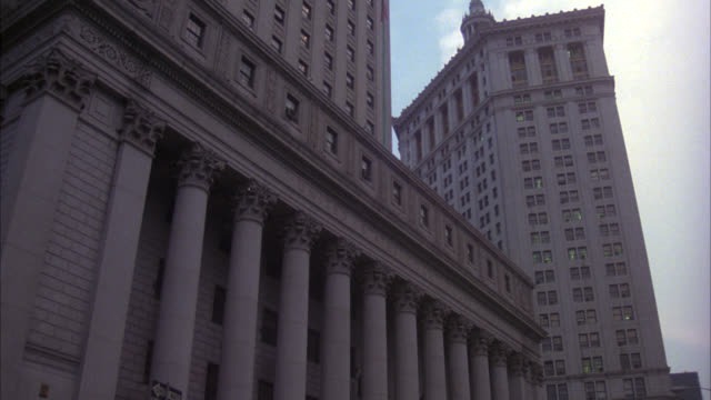up angle of civil branch of new york supreme court building, downtown. neoclassical columns or pillars. government building. courthouse. - corte suprema palazzo di giustizia video stock e b–roll