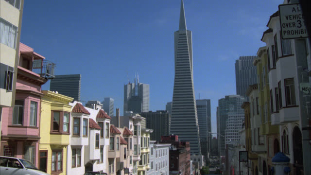 zoom in from city, downtown or financial district skyline. skyscrapers or high rise office buildings. transamerica pyramid. multi-story middle class apartment buildings in residential area in fg. zoom in on window. - middle class stock videos & royalty-free footage