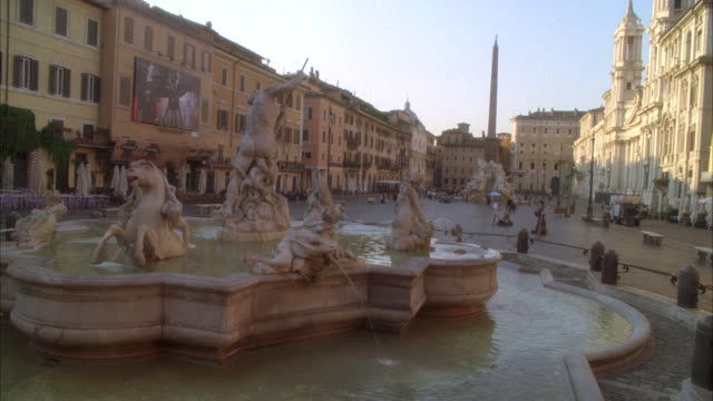 pan down to fountain of neptune, sculptures and statues in piazza navona, plaza or town square. - middle class stock videos & royalty-free footage