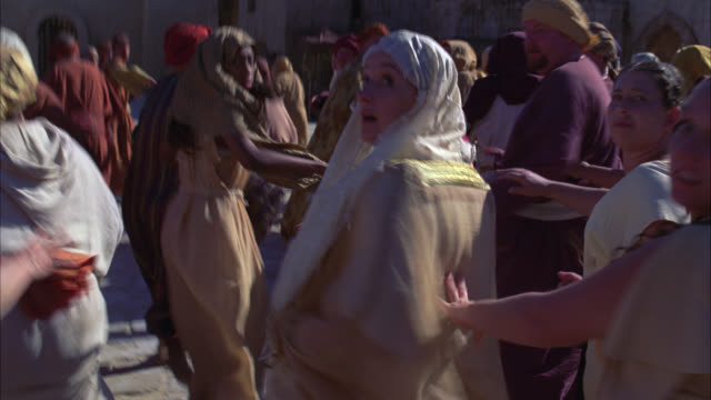medium angle of crowd of townspeople running. panic or emergency. could be in ancient middle east. biblical times. - biblical event stock videos & royalty-free footage