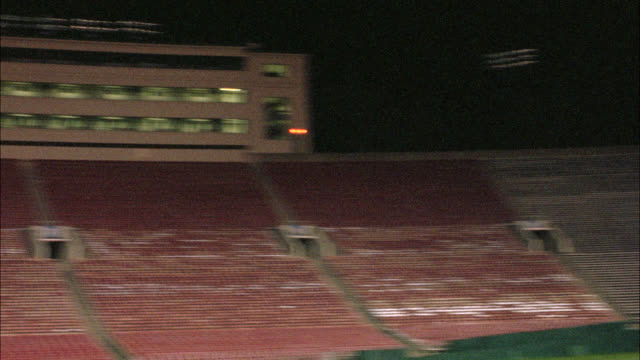 PAN RIGHT TO LEFT OF EMPTY ROSE BOWL STADIUM. FOOTBALL FIELD. BLEACHERS OR STANDS. LOS ANGELES AREA. SPORTS.