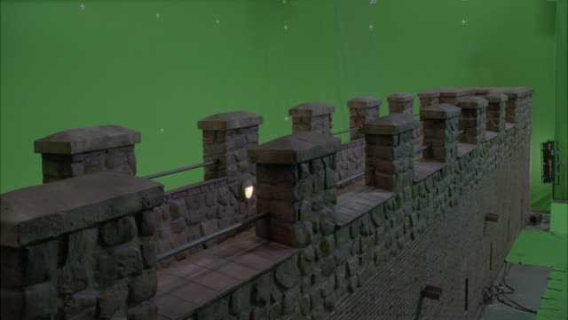 WIDE ANGLE OF STONE BRIDGE WITH CRENELLATION. GREEN SCREEN.
