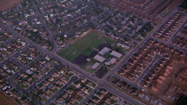 aerial / plane pov / stunt / residential neighborhood suburban area can be used as pov plane crash crashing. tract housing - tract housing stock videos & royalty-free footage