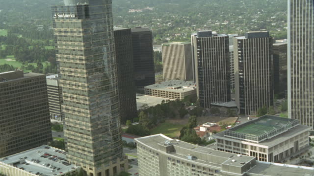aerial view of city of century city twin towers behind abc entertainment center and surrounding area. see identical high rise buildings next to each other. see pov pan down to streets, freeway, office buildings, and other multi-story buildings below. see - century city stock videos & royalty-free footage