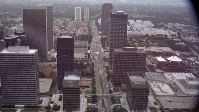 aerial view of high rise buildings, office buildings, streets, and freeways in century city. see century city twin towers behind abc entertainment center. see various cars on streets below. see golf course at edge of business district. - century city stock videos & royalty-free footage