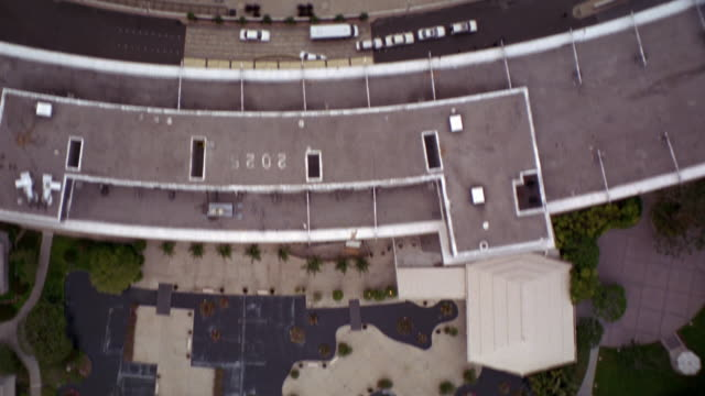 aerial birdseye pov of business district and residential area in century city. see century city twin towers behind abc entertainment center and surrounding area. see grass fields, tennis courts, corporate buildings, office buildings, parking lots, pools, - century city stock videos & royalty-free footage