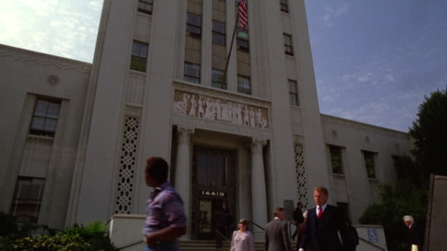medium angle of burbank city hall or official federal government building. activity out front. could also be police station, library, government building. matching shots. - burbank stock-videos und b-roll-filmmaterial
