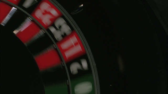 "close angle of roulette wheel spinning, ball lands in ""29 black"" casinos. gambling. hard rock casino.preview file has been trimmed from master clip 2045-018. for additional footage, see clips 2045-901 to 2045-909. full clip available by calling sony pictu - roulette stock videos and b-roll footage"