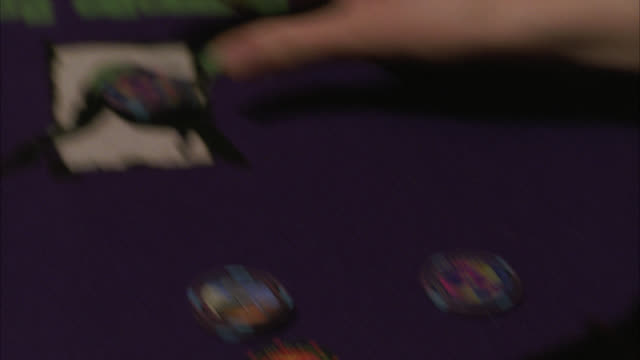 pan left to right of blackjack table. players' hands sort chips, dealer prepares table. gambling, casinos. hard rock casino.preview file has been trimmed from master clip 2045-019. for additional footage, see clips 2045-911 to 2045-914. full clip availabl - blackjack stock videos and b-roll footage