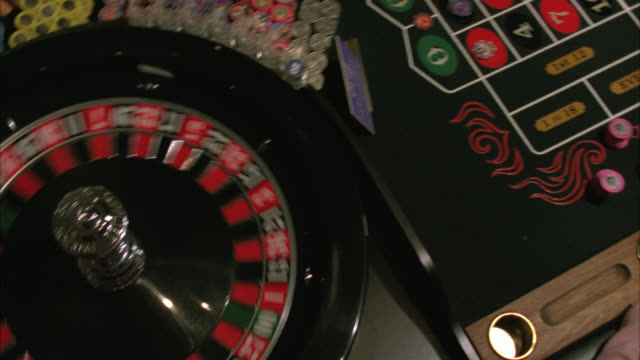 "medium angle of roulette wheel spinning. dealer spins the ball. players make bets on table. ball lands on ""36 roulette."" casinos. gambling chips. hard rock casino.preview file has been trimmed from master clip 2045-018. for additional footage, see clips 2 - roulette stock videos & royalty-free footage"