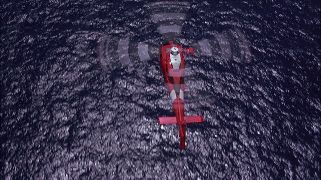 vidéos et rushes de aerial birdseye pov flying above coast guard helicopter as it is flying over the ocean. helicopter flies out of shot at end. - hélicoptère