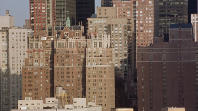 wide angle. est. high rise apartment buildings in new york city. brick buildings. tudor city apartments visible, midtown manhattan. - tudor stock videos and b-roll footage