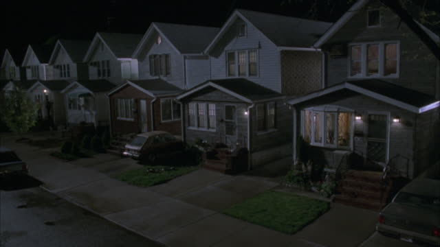 "wide angle of two story, middle class, suburban tract houses separated by narrow driveways. some pedestrians pass by. matching dx/nx shots 2281-025 to 2281-057.<p><a href=""https://www.sonypicturesstockfootage.com/footage?kid=4402"">for day-night matching s - tract housing stock videos & royalty-free footage"