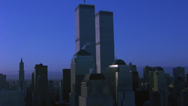 vídeos de stock e filmes b-roll de aerial around the world trade center twin towers. see high rises and skyscrapers surrounding wtc as camera pans from l-r. - world trade center manhattan