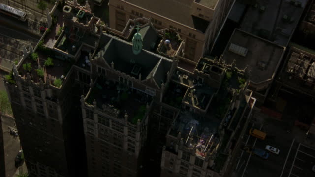 aerial birdseye pov over penthouse of brick apartment building with ramparts and spires. terraces, roof visible. tudor city apartments. upper class. midtown manhattan, east side. - penthouse stock videos and b-roll footage