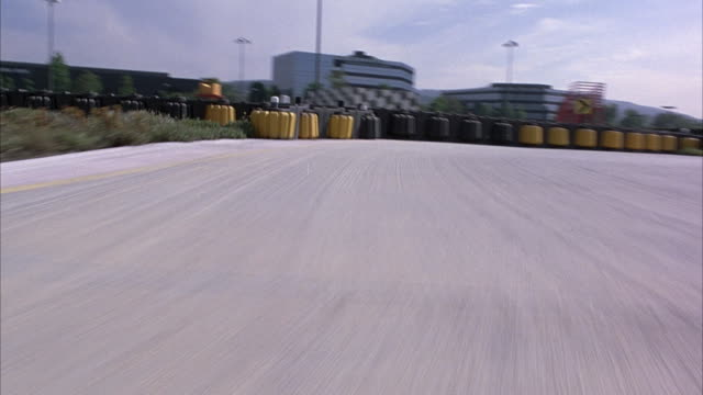 medium angle driving pov driving around go-cart track. - go cart stock videos & royalty-free footage