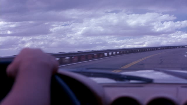 wide angle, driving pov of highway through desert mountain landscape. red rock.  hand of driver in the foreground. mountain road lined with railing along cliff. freeway. dashboard of 1978 mercedes-benz 450 sl. - mercedes benz stock videos and b-roll footage