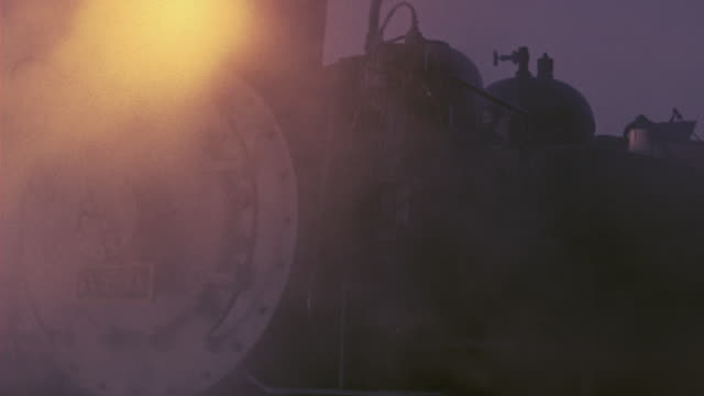 stockvideo's en b-roll-footage met close angle of steam engine train. train engine car has plaque with chinese characters on its front. headlight is on. train station. - 1946
