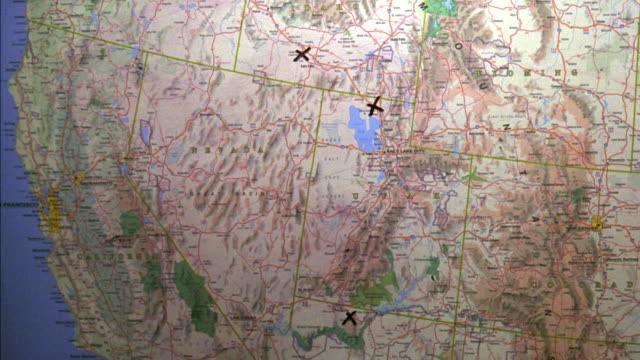 """close angle of map of western united states, america. a black """"x"""" is marked in three places on the map. one in southern idaho, one in northern utah, and one in northern arizona. after neg. cut, a fourth """"x"""" is shown in southern utah. - western usa stock videos & royalty-free footage"""