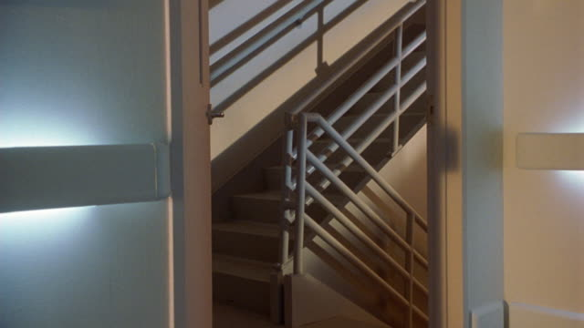 medium angle of flashing lights in stairwell. could be fire alarm or emergency in hospital, mental institution, office, or apartment building. see metal railing and stairs. - public building stock videos and b-roll footage
