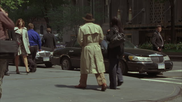 wide angle of pedestrians on new york street corner. park avenue  across from waldorf astoria hotel. see traffic and police cars with bizbars pull up in front of hotel across the street, as if starting a police action. - waldorf astoria stock videos and b-roll footage