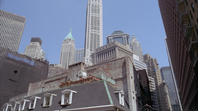 up angle of high rises and skyscraper of city skyline. empire state building visible and metlife tower. could be office buildings or apartment buildings. rooftops. - metlife hochhaus stock-videos und b-roll-filmmaterial