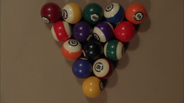 high angle down of racked billiards balls being broken. pool table felt is light brown. balls are broken and leave frame. series of shots. could be a pool hall, billiards hall, or bar. pool game. - pool hall stock videos and b-roll footage