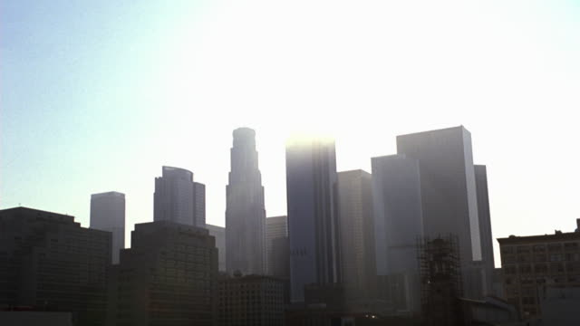 vídeos de stock, filmes e b-roll de pan down to downtown la city skyline with high rises, skyscrapers, and office buildings. - sony pictures entertainment