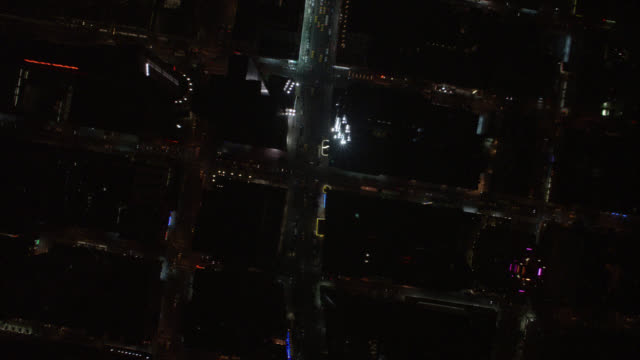 aerial birdseye pov of cars and taxis with headlights on city streets of midtown manhattan. follows broadway from new york landmark columbus circle - manhattan theater district stock videos and b-roll footage