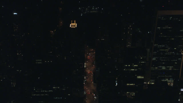 aerial of cars and taxis with headlights on city streets of midtown manhattan.  skyscrapers or multi-story buildings on city blocks near central park. new york. - {{ contactusnotification.cta }} stock-videos und b-roll-filmmaterial