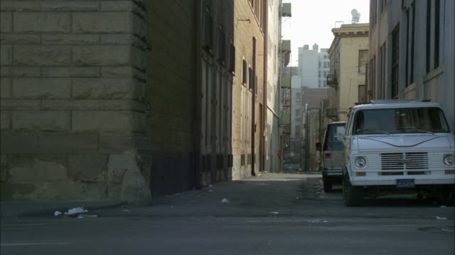 wide angle of alley in urban area. garbage littering the street. lower class. - 1984 stock videos & royalty-free footage