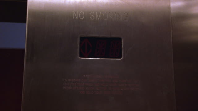 """wide angle of electronic elevator display showing direction of movement. arrow points up then down. """"no smoking"""" sign also seen. - no smoking sign stock videos & royalty-free footage"""