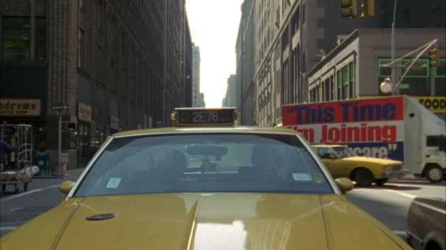 close up of hood of yellow taxi cab. looking down hood into windshield. - anno 1994 video stock e b–roll