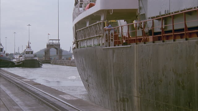 est wide angle on cargo ships sailing through lock along panama canal. - panama canal stock videos & royalty-free footage