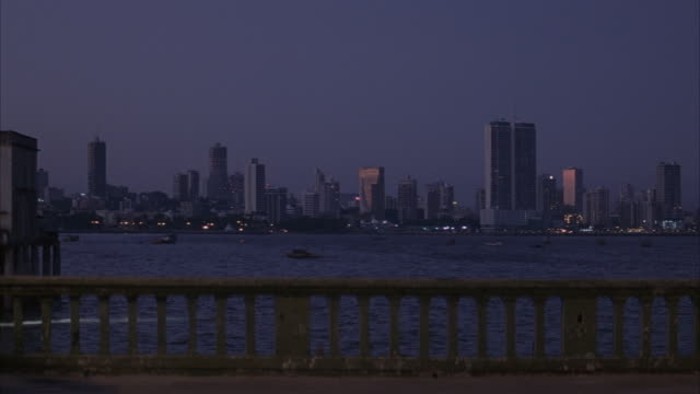 WIDE ANGLE OF PANAMA CITY SKYLINE. POV FROM BEHIND RAILING ON BRIDGE.