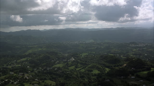 wide angle, landscape. see scattered houses and buildings below, mountains in background. could be any central or south american landscape. - {{ contactusnotification.cta }} stock videos & royalty-free footage