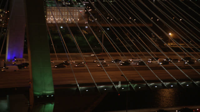 aerial pull back from cars driving on zakim bridge over charles river to wide angle of downtown boston city skylines. - river charles stock videos & royalty-free footage