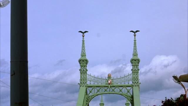wide angle of top of liberty bridge.  see only spires and sky. - liberty bridge budapest stock videos & royalty-free footage