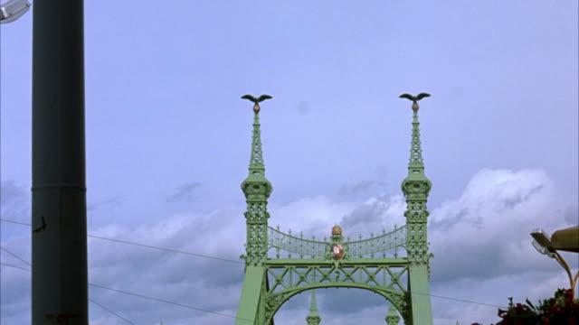 stockvideo's en b-roll-footage met wide angle of top of liberty bridge.  see only spires and sky. - kerktoren