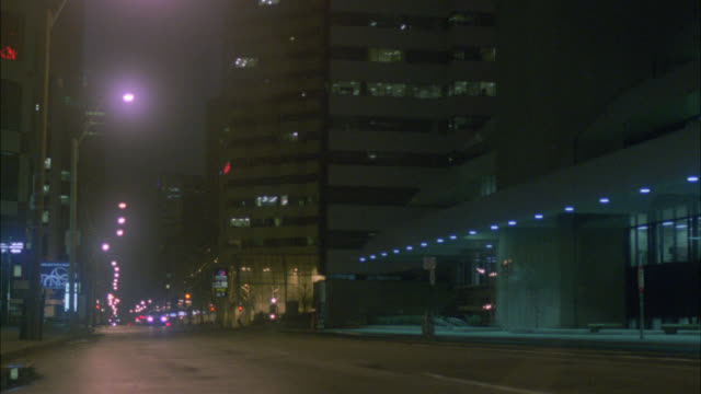 pan left to right of bmw car driving on deserted city street, then turning left. skyscrapers and high rise office or apartment buildings. commercial area or business district. - {{ contactusnotification.cta }} stock videos & royalty-free footage