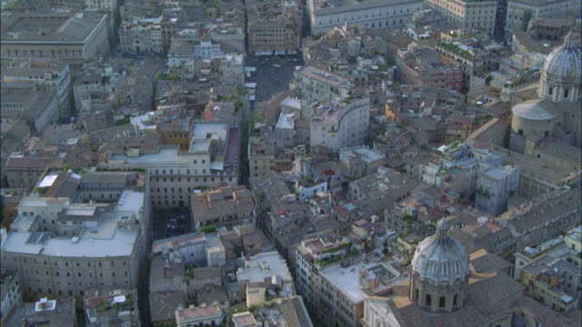 aerial of piazza navona, plaza or town square in city of rome. fountains. multi-story office or apartment buildings. red tile roofs. landmarks. - piazza navona stock videos & royalty-free footage