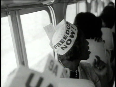 vídeos de stock e filmes b-roll de august 1963 montage bus passengers putting on makeup and hats getting ready for the march / washington dc united states - 1963