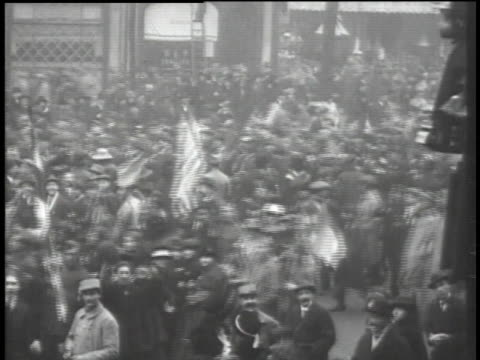 crowds marching at armistice parade / paris, france - 1918 stock videos & royalty-free footage