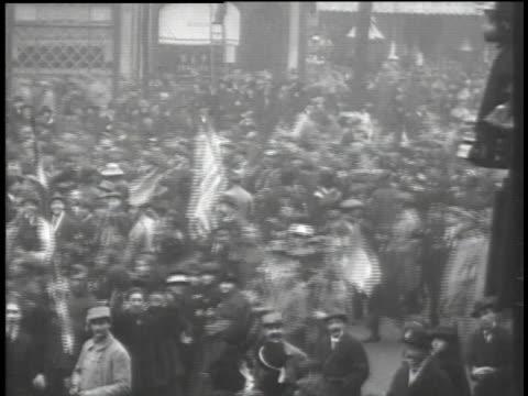 crowds marching at armistice parade / paris france - armistizio video stock e b–roll