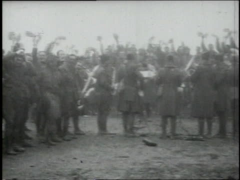 Soldiers standing waving helmets in celebration of Armistice as band plays / Verdun Lorraine France
