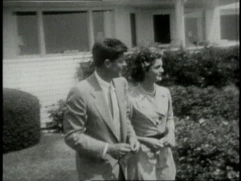 stockvideo's en b-roll-footage met john f kennedy walking with jacqueline kennedy onassis / cape cod massachusetts united states - jacqueline kennedy