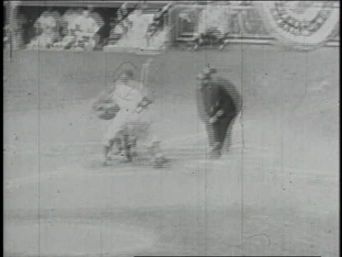 jackie robinson running and sliding into home base and umpire calling safe / united states - 1947年点の映像素材/bロール